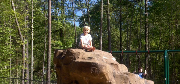 Liam, after climbing a rock at the park